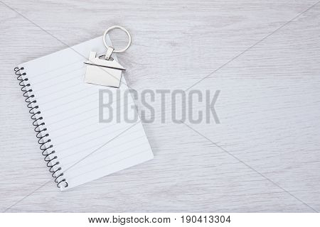 Blank Notepad With A Key Tag Of A House