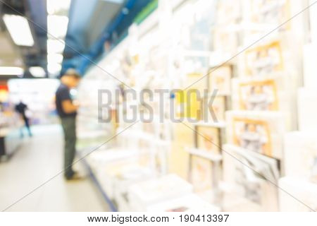 Blurred Background Of People Read Book At Bookshelves In Book Store