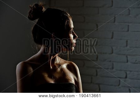 Pretty Girl With Hair Bun And Oily Or Wet Skin