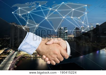 Deal or agreement business concept handshake double exposure cooperation or partnership business with global connection partnership map.
