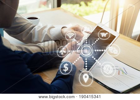 Businessman with a cup of coffee reading his digital tablet in a cafe. Online communication network digital 4.0 technology internet wireless application mobile smartphone
