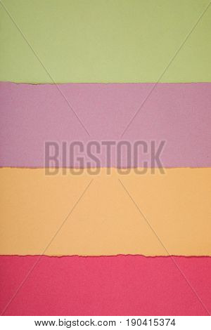 Rough Cut Strips Of Colored Paper In A Pattern