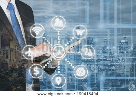 Double exposure of businessmen using digital tablet online communication network digital 4.0 technology internet wireless application mobile smartphone.