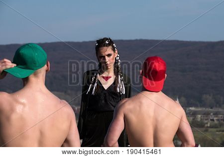 Criminal Girl With Braids And Two Men With Naked Backs