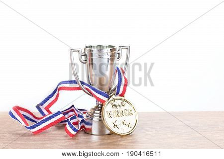 Silver Trophy With Gold Medallion On A Ribbon