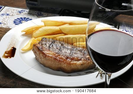 Picanha Steak with fries and red wine