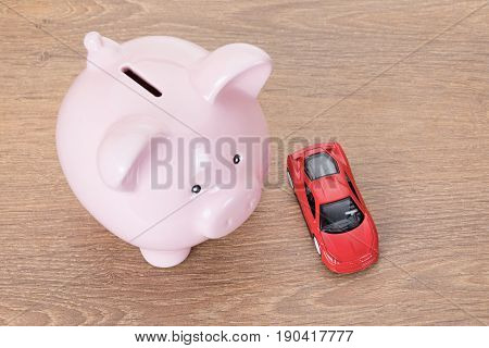 Pink Piggy Bank With Red Toy Car