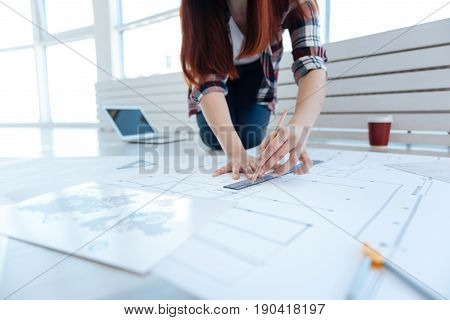 Engineering drawing. Professional engineering draft being drawn by a nice hard working creative woman while developing the building design