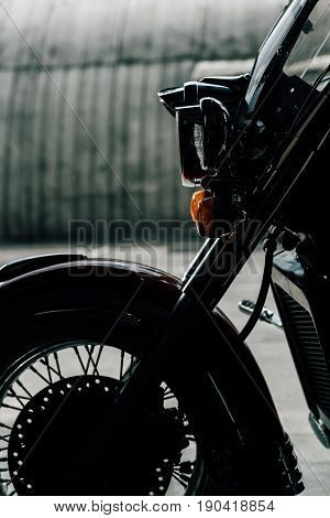 Close-up view of classic motorbike parked on pavement outdoors