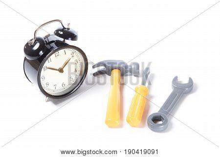 Classic Alarm Clock And Plastic Toy Tools