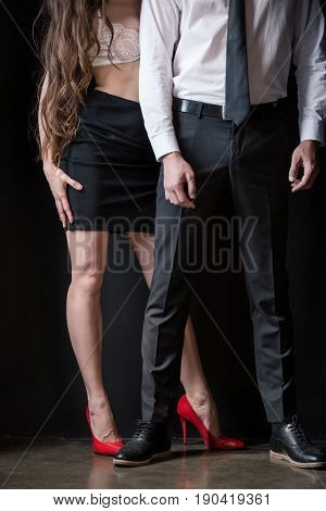cropped shot of sexy woman in skirt and bra standing with man in formal wear