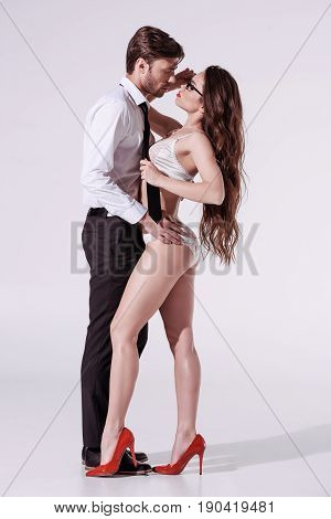 Passionate Woman In White Underwear Seducing Elegant Man In Formal Wear