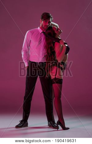 Sexy Girl In Lingerie And Stockings Seducing Elegant Man