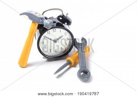 Alarm Clock With Pile Of Toy Tools