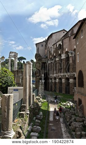Rome, Italy - April 15, 2017: Roman Forum - square in the heart of ancient Rome, along with surrounding buildings.
