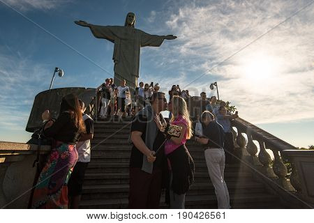 Rio de Janeiro, Brazil - May 24, 2017: People visiting Christ the Redeemer statue, enjoying the view, taking pictures.