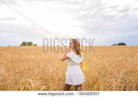 Quiet, secret and trust concept. Woman hand with silence sign symbol on nature