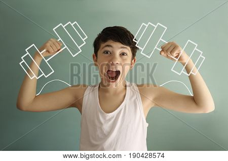 teenager kid boy show biceps with dumb bells drawn with chalk funny photo