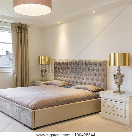 Spacious Bedroom With Upholstered Bed