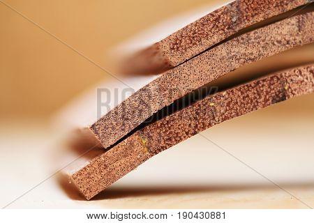 Merbau wood planks for handmade drum closeup selective focus