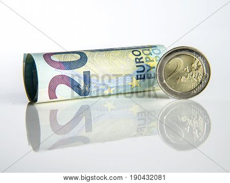 Euro money euro bank notes and coins with white background detail money reflection