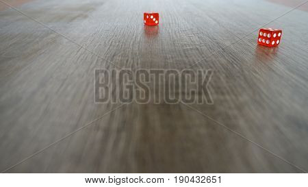 Throwing red dice on a grey background in the casino. Slow motion.