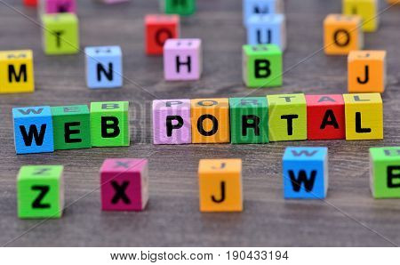 Web portal words on wooden table closeup