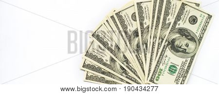Cash money dollar on white. Background with money american hundred dollar bills. Long banner format.