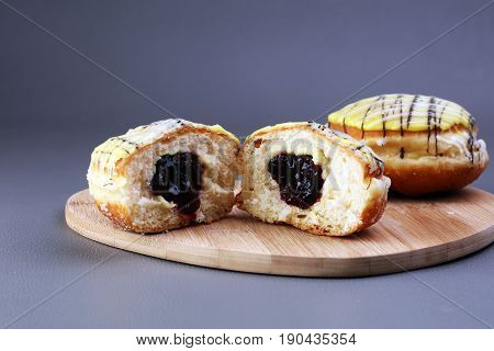 German Donuts - Berliner With Jam And Icing Sugar In A Tray On A Grey Background.