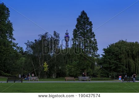LONDON, GREAT BRITAIN - MAY 17, 2014: It's an evening on one of the Regent's Park alleys beyond which you can see the BT tower.