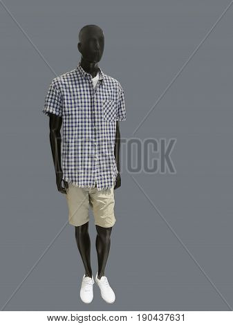 Full-length male mannequin dressed in casual clothes isolated on gray background. No brand names or copyright objects.