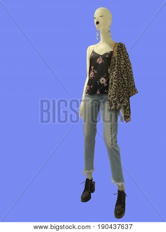 Full-length female mannequins dressed in fashionable clothes isolated. No brand names or copyright objects.