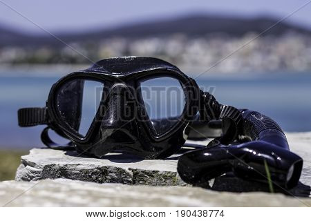 Diving glasses and snorkle in the sun