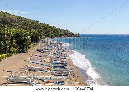 Many traditional fishing boats on a beach close to Amed on Bali, Indonesia