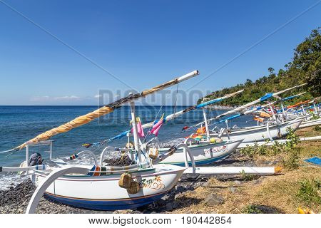 Bali, Indonesia - July 07, 2015: A lot of traditional fishing boats on a beach close to Amed
