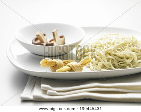 vegetarian noodle in plate with mushroom