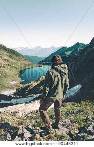 Man explorer wander lake in mountains aerial view Travel Lifestyle adventure concept summer vacations outdoor harmony with nature
