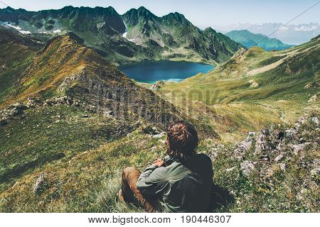 Man traveler wander blue lake in mountains aerial view landscape Travel Lifestyle adventure concept summer vacations outdoor harmony with nature