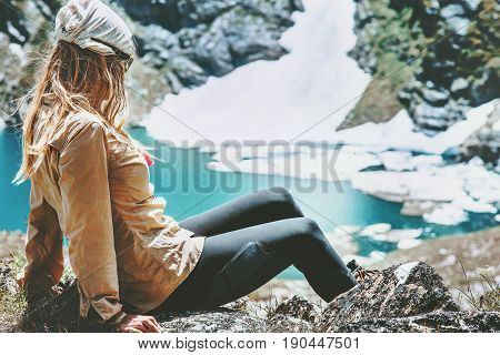 Hiker woman relaxing at blue lake in mountains Travel Lifestyle wanderlust concept summer vacations outdoor harmony with nature