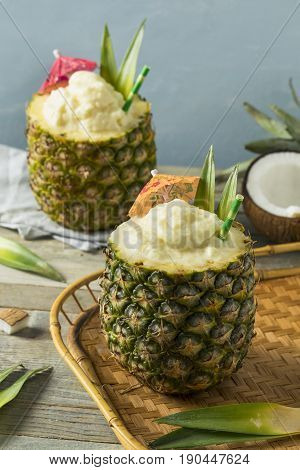Frozen Pina Colada Cocktail In A Pineapple