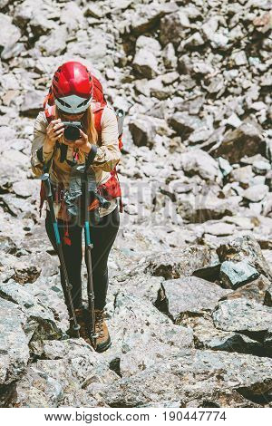 Hiker photographer taking photo of mountains Travel Lifestyle adventure concept active vacations outdoor hiking mountaineering