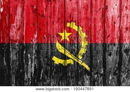 Flag of Angola painted on wooden frame