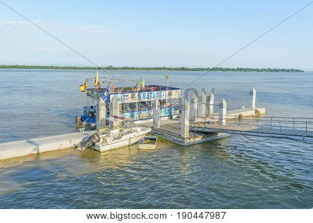 GUAYAQUIL, ECUADOR, MAY - 2016 - Touristic boat parked at small dock at guayas river at the coast of Guayaquil in Ecuador
