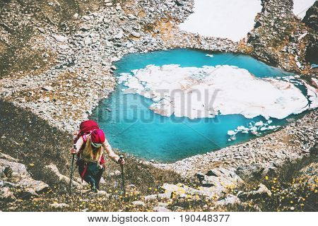 Traveler woman climbing to mountains summit blue lake aerial view Travel Lifestyle adventure concept summer vacations outdoor