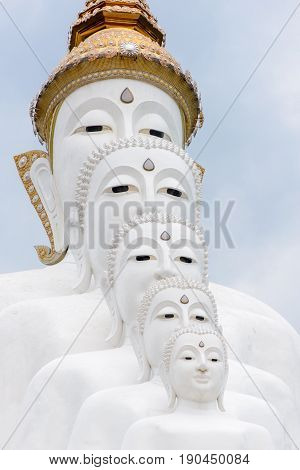 May 9 2017. Close-up detail of five white statues of Lord Buddha sitting in front of each other in decreasing size. Wat Pha Sorn Kaew Phetchabun Thailand. Travel and architecture editorial.
