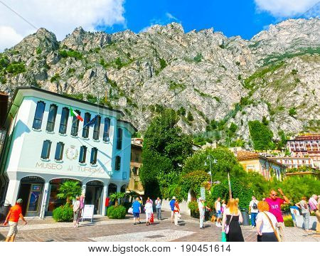 Limone sul Garda, Italy - September 21, 2014: The people walking on the street of famous village Limone sul Garda on Lake Garda, Italy