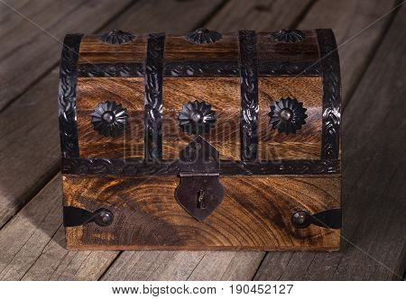Wooden treasure chest on a wood surface