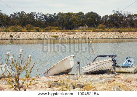 modest fishing boats in the river bank in Guardamar del Segura Alicante.Spain