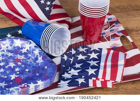 Fourth of july party plates cups and napkins on a tray