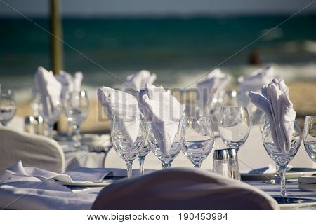 Tables And Decoration For A Wedding On The Beach